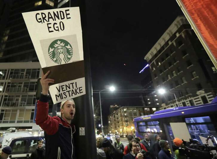 David Schwartz, of Bellevue, Wash., yells as he takes part in a protest outside a book-promotion event held by former Starbucks CEO Howard Schultz, Thursday, Jan. 31, 2019, in Seattle. Schultz has faced a rocky reception since he announced earlier in January that he's considering an independent presidential bid. (AP Photo/Ted S. Warren)