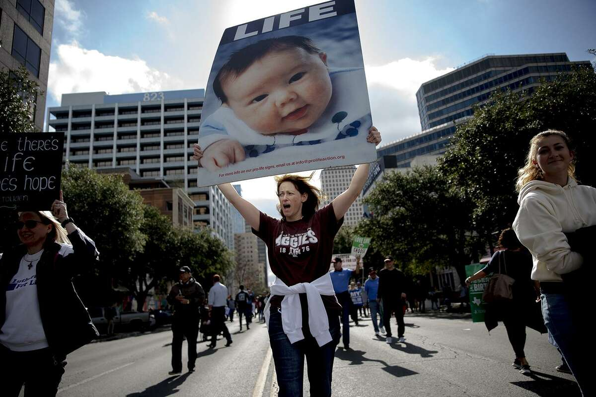 """Colleen Sullivan chants while taking part in an anti-abortion march on Saturday, Jan. 26, 2019, in Austin, Texas. The event was part of annual """"March for Life"""" events held across the country, near the Jan. 22, 1973 anniversary of the Supreme Court's Roe v. Wade decision, which legalized abortion. (Nick Wagner/Austin American-Statesman via AP)"""