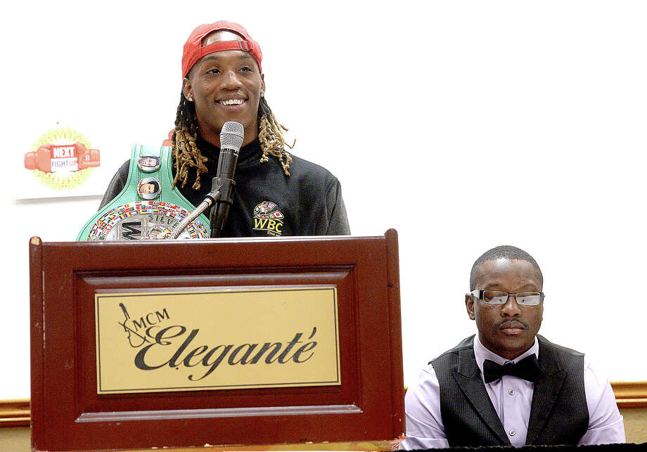 O'Shaquie Foster, world champion boxer out of Orange speaks during a press conference at the MCM Elegante Hotel for NEXT Fight UP : Fight Night in the 409, scheduled for Saturday, February 23, at the Beaumont Civic Center. Foster will fight in the main event of the show. MMA fighter Joel Scott of Port Arthur, at right, is also scheduled for a boxing match. 