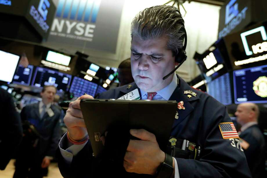 FILE- In this Feb. 5, 2019, file photo trader John Panin works on the floor of the New York Stock Exchange. The U.S. stock market opens at 9:30 a.m. EST on Monday, Feb. 11. (AP Photo/Richard Drew, File) Photo: Richard Drew / Copyright 2019 The Associated Press. All rights reserved.