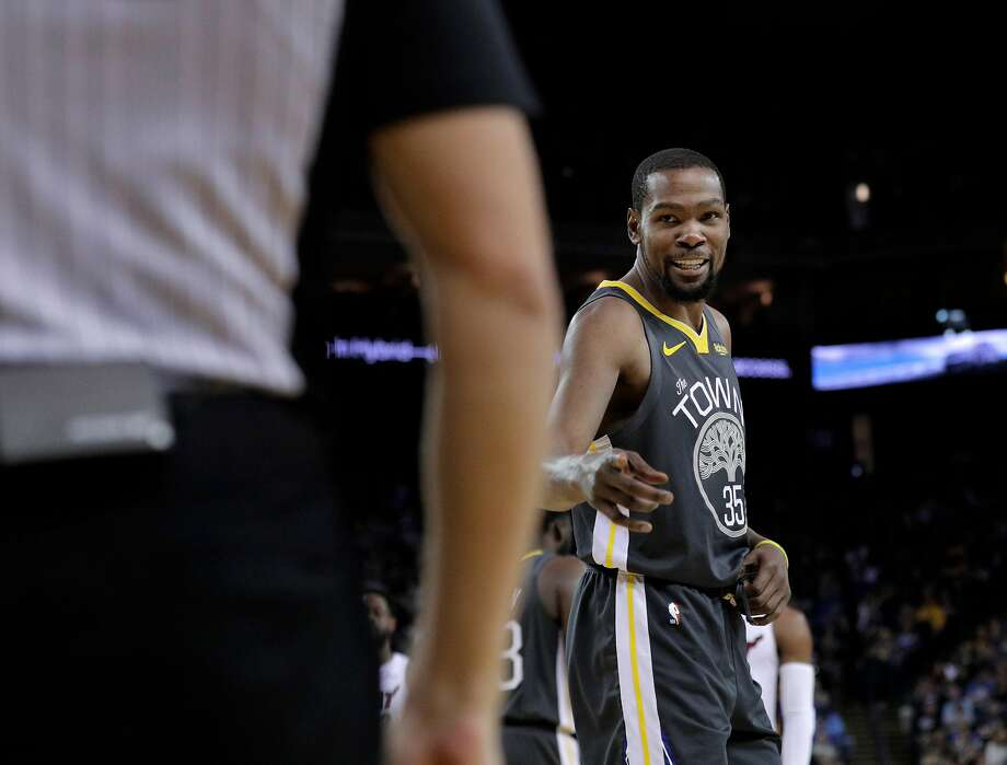 Kevin Durant (35) talks to referee Jason Goldenberg (35) after he was assessed a technical foul in the second half as the Golden State Warriors played the Miami Heat at Oracle Arena in Oakland, Calif., on Sunday, February 10, 2019. Photo: Carlos Avila Gonzalez / The Chronicle