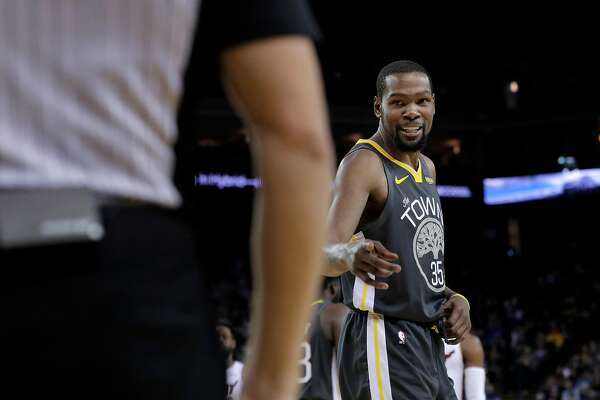 Kevin Durant (35) talks to referee Jason Goldenberg (35) after he was assessed a technical foul in the second half as the Golden State Warriors played the Miami Heat at Oracle Arena in Oakland, Calif., on Sunday, February 10, 2019.