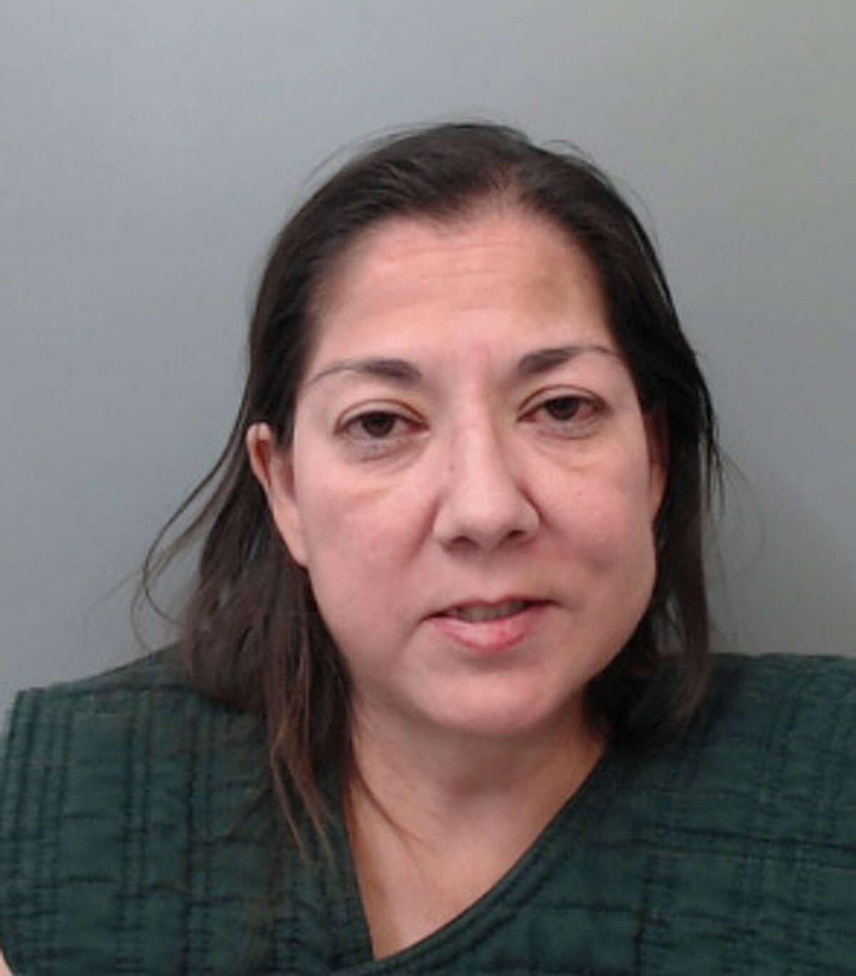 Amy Ann Alaniz, 49, was charged with making silent abusive calls to 911 and resisting arrest.