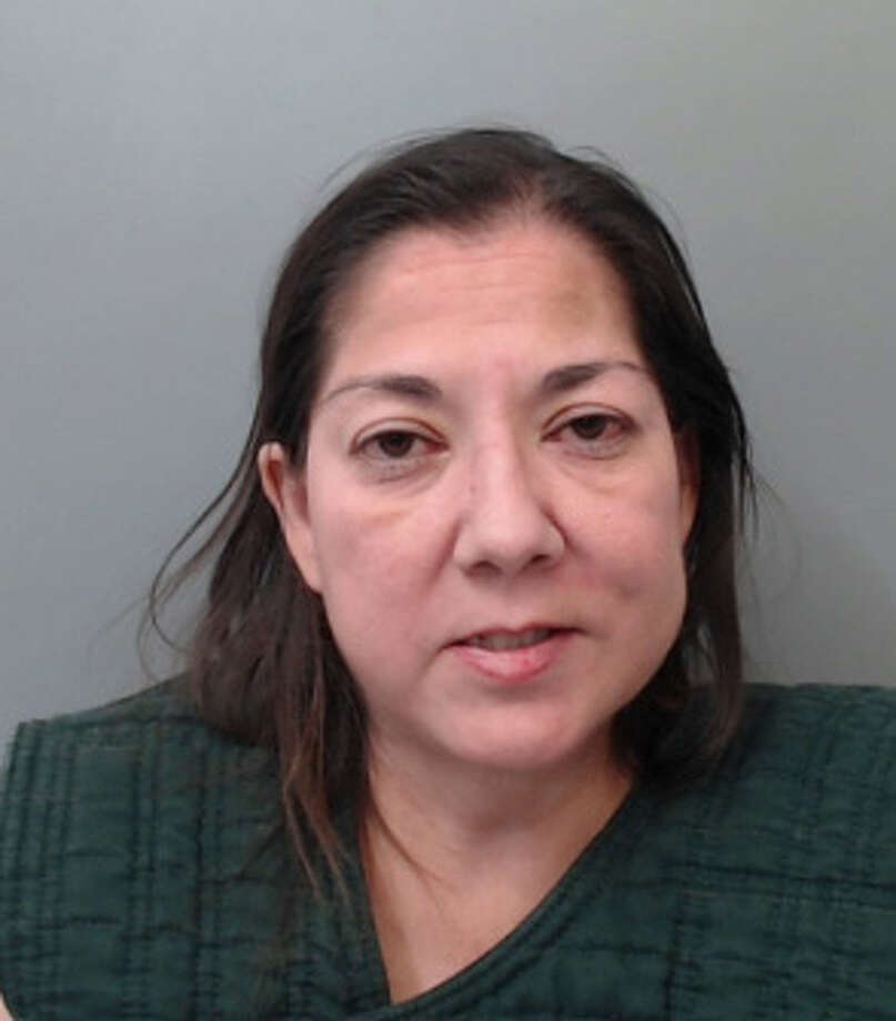 Amy Ann Alaniz, 49, was charged with making silent abusive calls to 911 and resisting arrest. Photo: Webb County Sheriff's Office