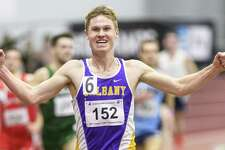 Columbia High graduate Kyle Gronostaj of the UAlbany men's indoor track team after breaking the school record in the 5,000 at the Valentine Invitational at Boston University. (Courtesy of America East Conference)