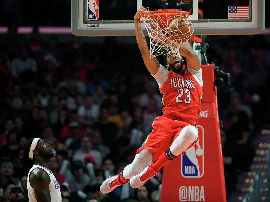 FILE - In this April 9, 2018, file photo, New Orleans Pelicans forward Anthony Davis dunks as Los Angeles Clippers forward Montrezl Harrell watches during the second half of an NBA basketball game, in Los Angeles.  Only a few hours remain to determine if the Anthony Davis saga ends for this season or lingers into the summer. The NBA trade deadline is Thursday, Feb. 7, 2019, at 3 p.m. EST, and Davis is still seeking a trade from the New Orleans Pelicans.(AP Photo/Mark J. Terrill, File) Photo: Mark J. Terrill / Copyright 2018 The Associated Press. All rights reserved.
