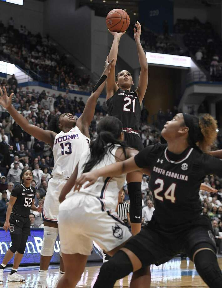 South Carolina's Mikiah Herbert Harrigan (21) makes a basket as UConn's Christyn Williams (13) defends during the first half of Monday's game in Hartford. Photo: Jessica Hill / Associated Press / Copyright 2019 The Associated Press. All rights reserved