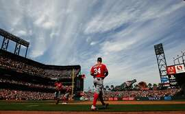 SAN FRANCISCO, CA - AUGUST 16:  Bryce Harper #34 of the Washington Nationals walks back out to the field during their game against the San Francisco Giants at AT&T Park on August 16, 2015 in San Francisco, California.  ~~