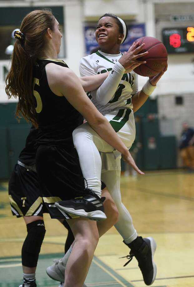 Norwalk's Carsyn Langhorn drives to the ball against Trumbull defender Krystina Schueler on Feb. 11. Photo: Brian A. Pounds / Hearst Connecticut Media / Connecticut Post