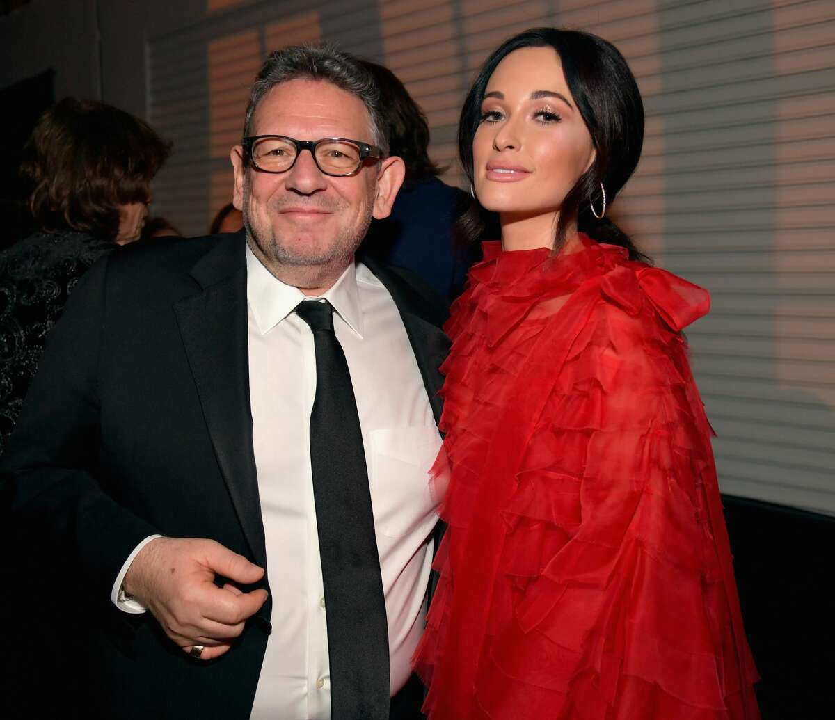LOS ANGELES, CA - FEBRUARY 10: UMG Chairman & CEO Sir Lucian Grainge (L) and Kacey Musgraves attend Universal Music Group's 2019 After Party Presented by Citi Celebrates Music's Biggest Night on February 9, 2019 in Los Angeles, California.(Photo by Lester Cohen/Getty Images for Universal Music Group)