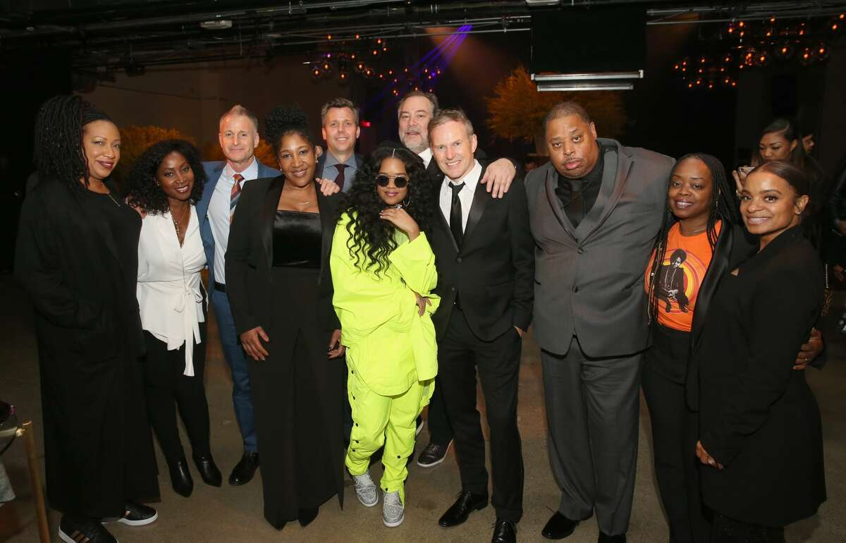 LOS ANGELES, CA - FEBRUARY 10: (L-R) EVP of Marketing at RCA Records Carolyn Williams, EVP of Creative Content at RCA Records Camille Yorrick, President of A&R at RCA Records Keith Naftaly, MBK Entertaiment's Jeanine McLean, Co-President of RCA Records John Fleckenstein, H.E.R., Co-President of RCA Records Joe Riccitelli, CEO & Chairman of RCA Records Peter Edge, MBK Entertainment's Jeff Robinson, SVP of Publicity at RCA Records Theola Borden, and MBK Entertainment's Misha Mayes attend the Sony Music Entertainment 2019 Post-Grammy Reception at NeueHouse Hollywood on February 10, 2019 in Los Angeles, California. (Photo by Jesse Grant/Getty Images for SME)