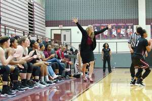 Pearland head girls' basketball coach Lauren Martens and the Lady Oilers, shown in action earlier this season, defeated Clear Lake, 49-43, in a Class 6A bi-district playoff game Monday night in Friendswood.