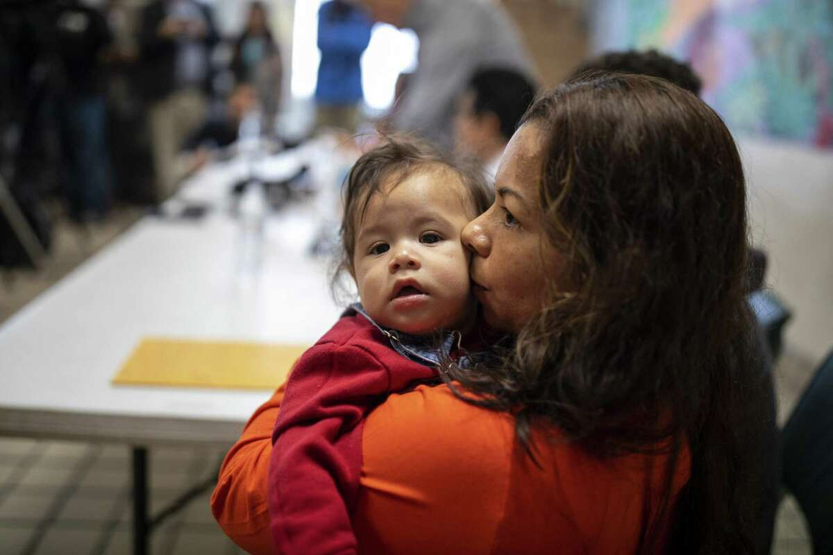 Linda Noriega of Honduras embraces her son during a press conference Annunciation House Monday, February 11, 2019, in El Paso, TX. Linda and her husband and other son entered the U.S. illegally and were all recently reunited. Photo by Ivan Pierre Aguirre for the San Antonio Express-News