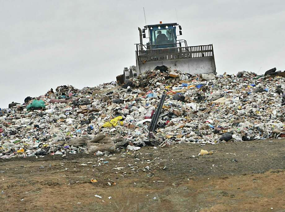 A tractor is seen moving garbage at the Colonie Landfill on Wednesday, Feb. 6, 2019 in Colonie, N.Y. (Lori Van Buren/Times Union) Photo: Lori Van Buren / 40046141A