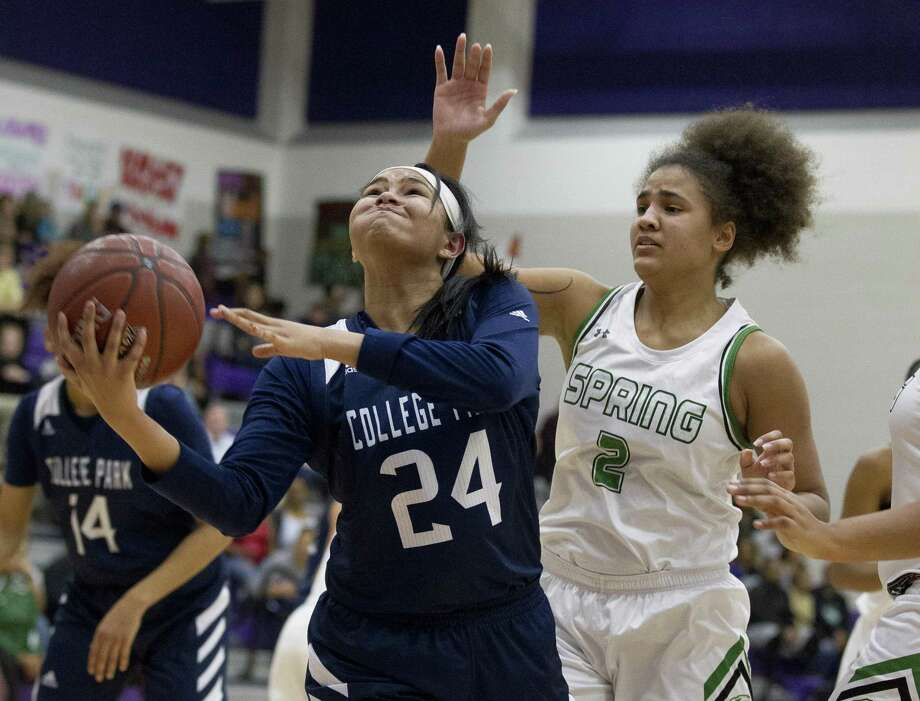 College Park guard Talynne Buckmon (24) gets past Spring small forward Haley Wesley (2) for a layup during the first quarter of a Region II-6A bi-district high school basketball game at Klein Cain High School, Monday, Feb. 11, 2019, in Houston. Photo: Jason Fochtman, Houston Chronicle / Staff Photographer / © 2019 Houston Chronicle