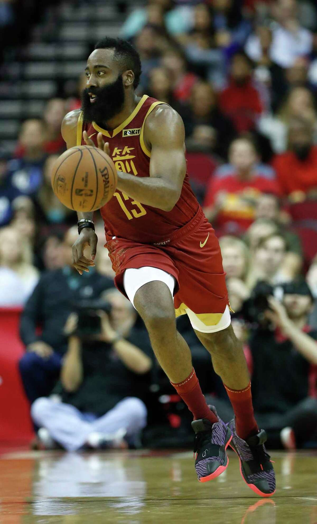 Houston Rockets guard James Harden (13) takes the ball up the court during the first half of an NBA game at the Toyota Center, Monday, Feb. 11, 2019, in Houston.