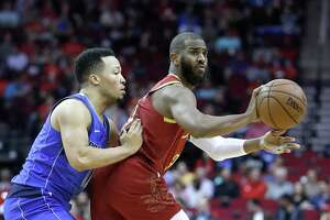 Houston Rockets guard Chris Paul (3) looks to pass the ball around Dallas Mavericks guard Jalen Brunson (13) during the first half of an NBA game at the Toyota Center, Monday, Feb. 11, 2019, in Houston.