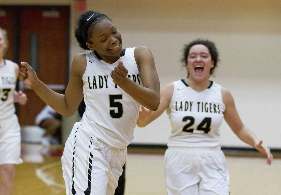 Conroe's Jakayla Bradford (5) reacts in front of teammate Gabriela Morazan (24) after defeating Aldine Davis 44-35 during a Region II-6A bi-district high school basketball game on Monday evening. Photo: Jason Fochtman, Houston Chronicle / Staff Photographer / © 2019 Houston Chronicle