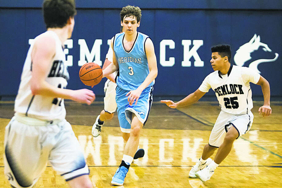 Meridian's Lucas Lueder brings the ball upcourt in a game vs. Hemlock earlier this season. Lueder had 13 points, seven rebounds, six assists, and two steals in the Mustangs' win over Dow on Monday. Photo: Daily News File Photo