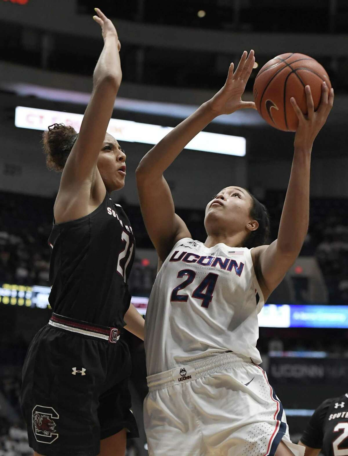 UConn's Napheesa Collier, right, shoots over South Carolina's Mikiah Herbert Harrigan durig Monday night's 97-79 win. Collier finished with 31 points, 16 rebounds and six assists.
