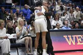 UConn coach Geno Auriemma embraces Napheesa Collier after she exited Monday's win over South Carolina in Hartford.