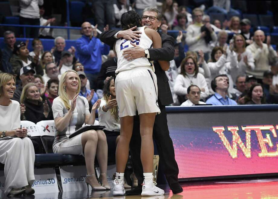UConn coach Geno Auriemma embraces Napheesa Collier after she exited Monday's win over South Carolina in Hartford. Photo: Jessica Hill / Associated Press / Copyright 2019 The Associated Press. All rights reserved