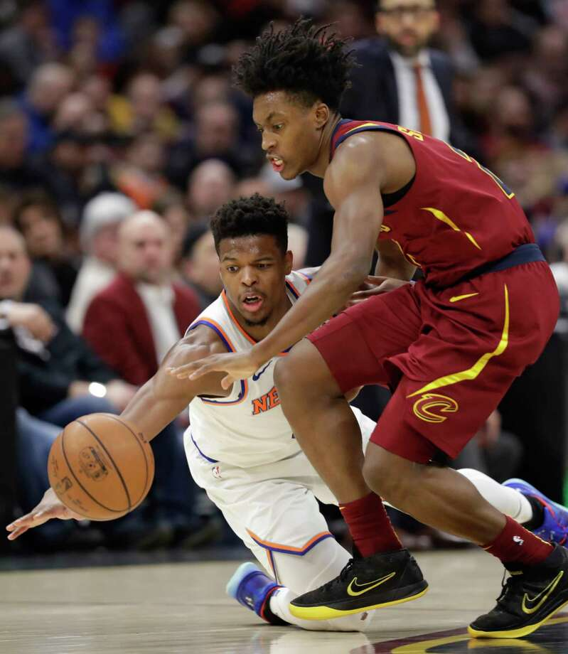 New York Knicks' Dennis Smith Jr., left, and Cleveland Cavaliers' Collin Sexton battle for a loose ball in the second half of an NBA basketball game, Monday, Feb. 11, 2019, in Cleveland. The Cavaliers won 107-104. (AP Photo/Tony Dejak) Photo: Tony Dejak / Copyright 2019 The Associated Press. All rights reserved.
