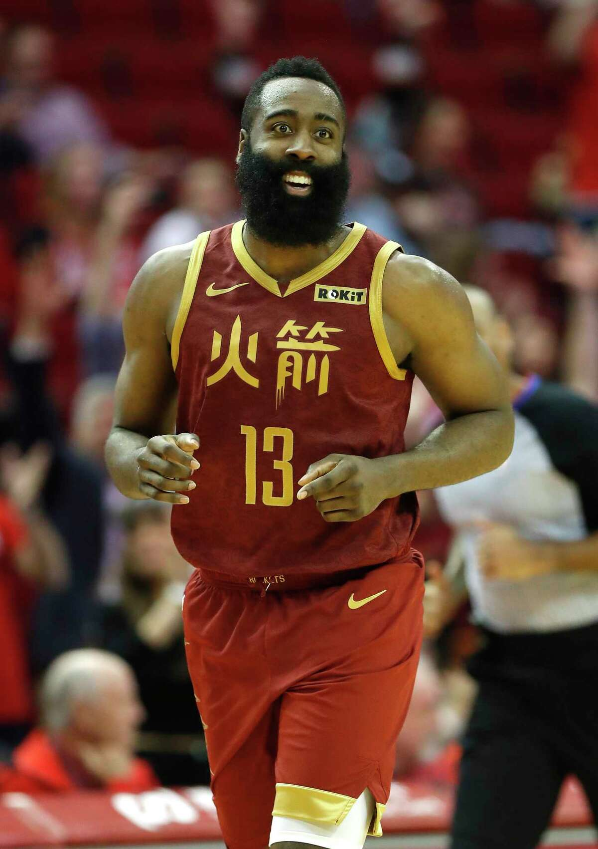Houston Rockets guard James Harden (13) reacts after a three-pointer during the second half of an NBA game at the Toyota Center, Monday, Feb. 11, 2019, in Houston.