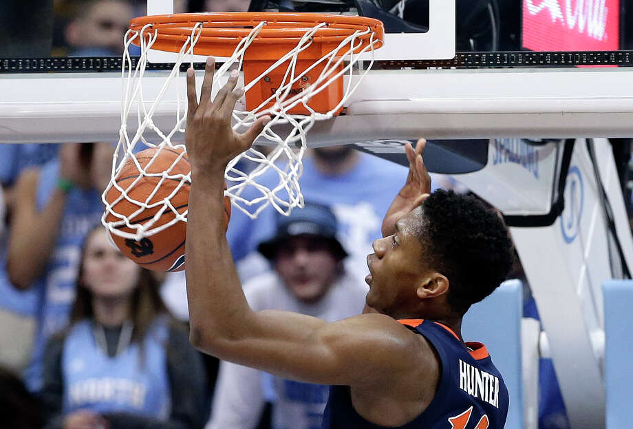 Virginia's De'Andre Hunter dunks against North Carolina during the first half of an NCAA college basketball game in Chapel Hill, N.C., Monday, Feb. 11, 2019. (AP Photo/Gerry Broome) Photo: Gerry Broome / Copyright 2019 The Associated Press. All rights reserved