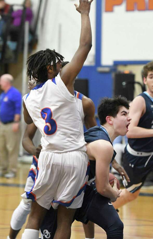 Wilton's Nicholas Kronenberg, right, tries to get by Danbury's Keyon Moore (3) and Denali Burton (obstructed) during the Wilton at Danbury boys basketball game, Feb. 11, 2019. Photo: Krista Benson / The News-Times Freelance