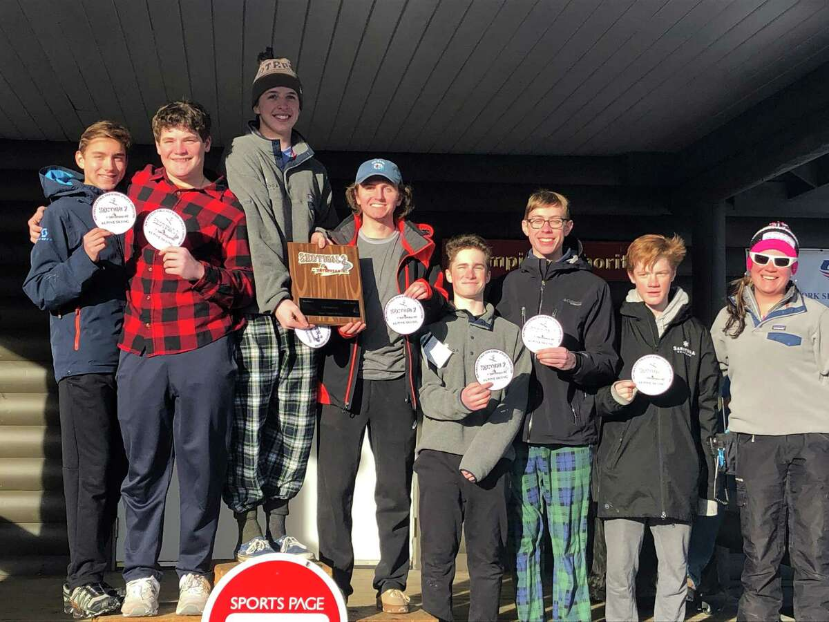 Saratoga's winning alpine skiing team. From left to right, Tyler Munter, Nathan Rodriguez, Max Hefner, Bryce North, Matt Moeckel, Kevin Joyce, Lucas Dougherty and coach Megan Beck. (Courtesy of Megan Beck)