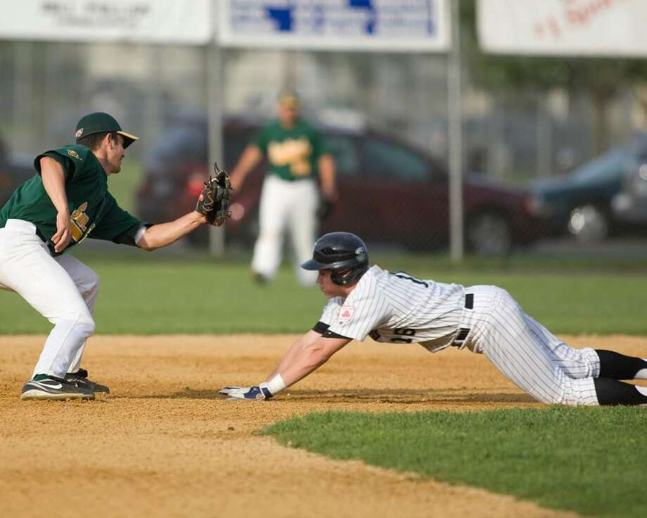 The Westerners' Brett Knief is cut down trying to steal second Thursday night at Rogers Park. Sanford Mainers' shortstop Marlon Calbi applies the tag. Photo: Barry Horn / The News-Times Freelance