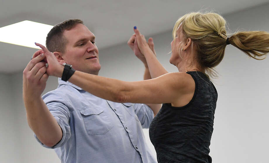 Dr. Brian Broaddus and Gracelyn Miller practice their Dancing with the Stars routine at Marsha Woody on Friday. The dance was choreographed by Tammy Anderud. Photo taken Friday, 2/8/19 Photo: Guiseppe Barranco/The Enterprise / Guiseppe Barranco ©