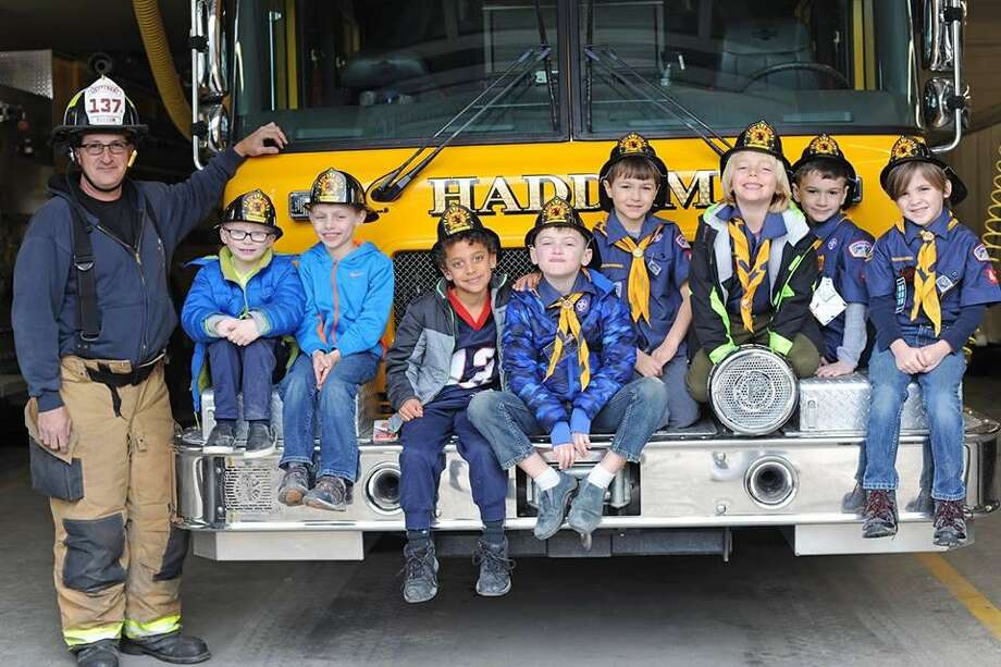 Connecticut Rivers Council Pack 40 Den 7 Wolf Scouts of Higganum visited Haddam Volunteer Fire Company earlier this month for a hometown heroes adventure. Photo: Olivia Drake Photo