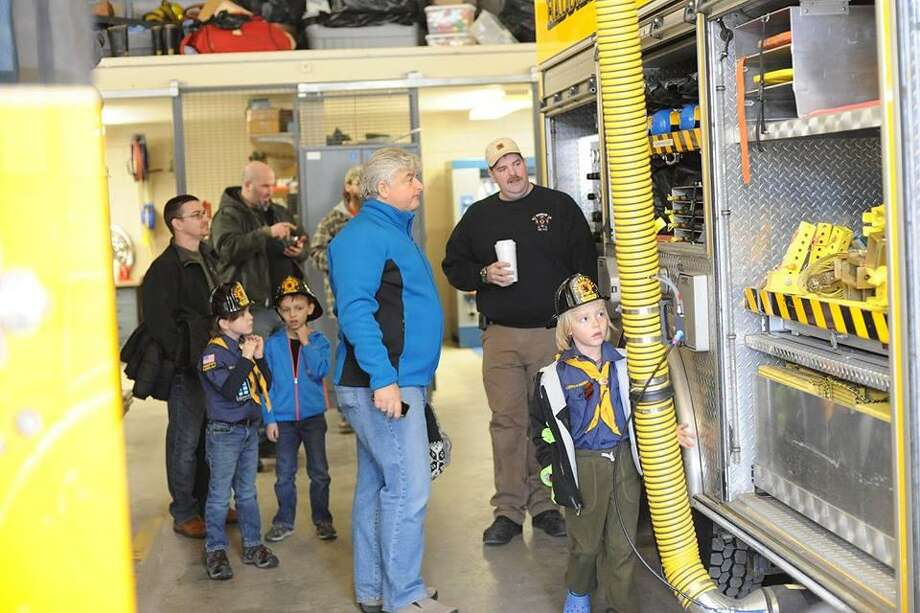 Wolf Scouts of Higganum visit the Haddam Volunteer Fire Co. for a hometown heroes adventure. Photo: Olivia Drake Photo
