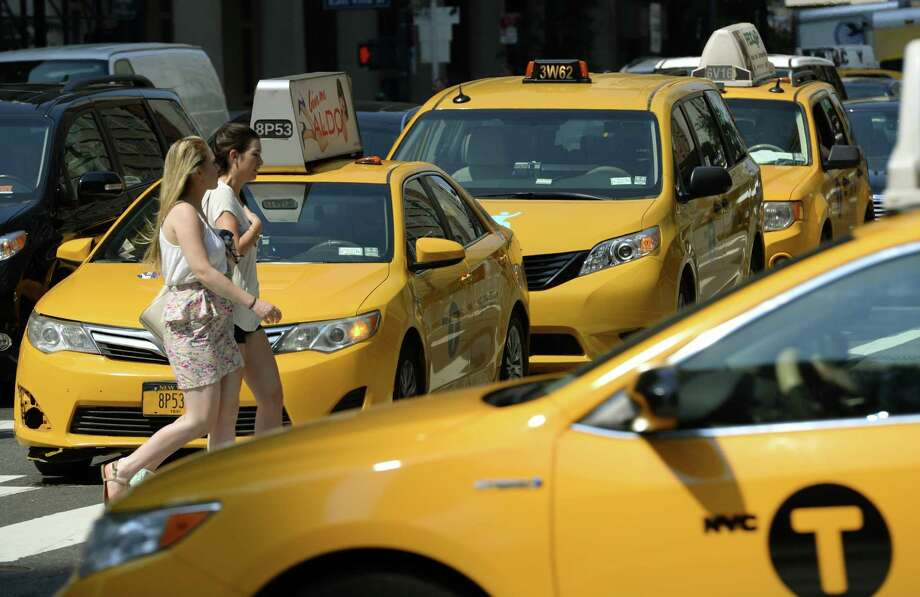 A new $2.50 surcharge has taken effect for New York City cabs. Photo: Timothy A. Clary / Getty Images / AFP