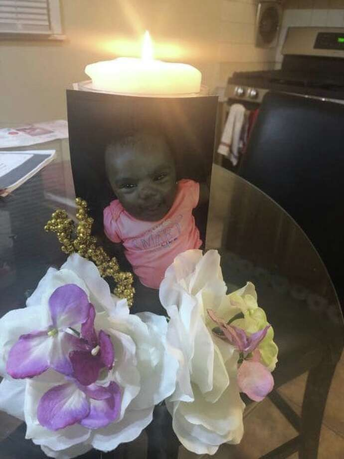 The family of Enita Salubi lit candles for the girl praying for a guilty verdict in her case. Enita was 8-months-old when she was fatally force-fed milk by her nanny. Photo: Family Photo