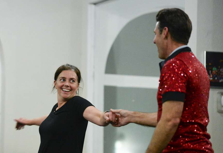 Annie Tyner and Slate Babineaux practice for the Dancing with the Stars at iRule Dance on Tuesday.   Photo taken on Tuesday, 02/06/19.  Ryan Welch/The Enterprise Photo: Ryan Welch/The Enterprise