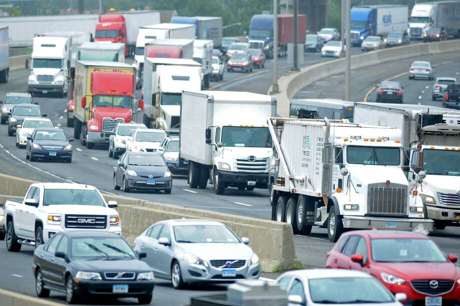 Trucks crawl northbound on Interstate 95 in July 2017 in Bridgeport, Conn. Amid a shortage of truck drivers in the Northeast and nationally, New England Motor Freight filed on Feb. 11, 2019 for bankruptcy protection from creditors and stated its intent to go out of business. Photo: Ned Gerard / Hearst Connecticut Media / Connecticut Post