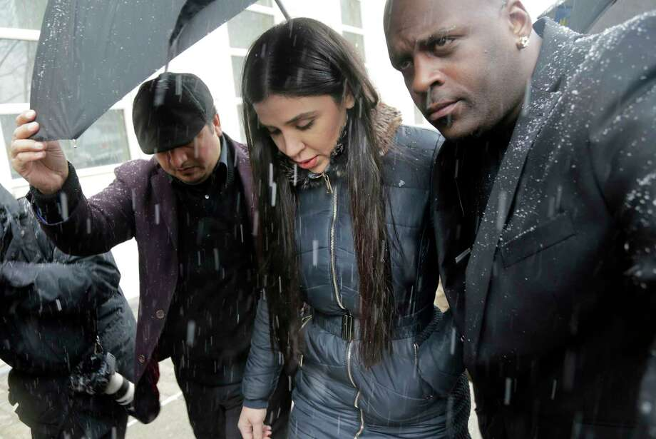 "Emma Coronel Aispuro, center, wife of Joaquin ""El Chapo"" Guzman, arrives to federal court in New York, Tuesday, Feb. 12, 2019. A jury is deliberating at the U.S. trial of the infamous Mexican drug lord. Photo: Seth Wenig, AP / Copyright 2019 The Associated Press. All rights reserved."