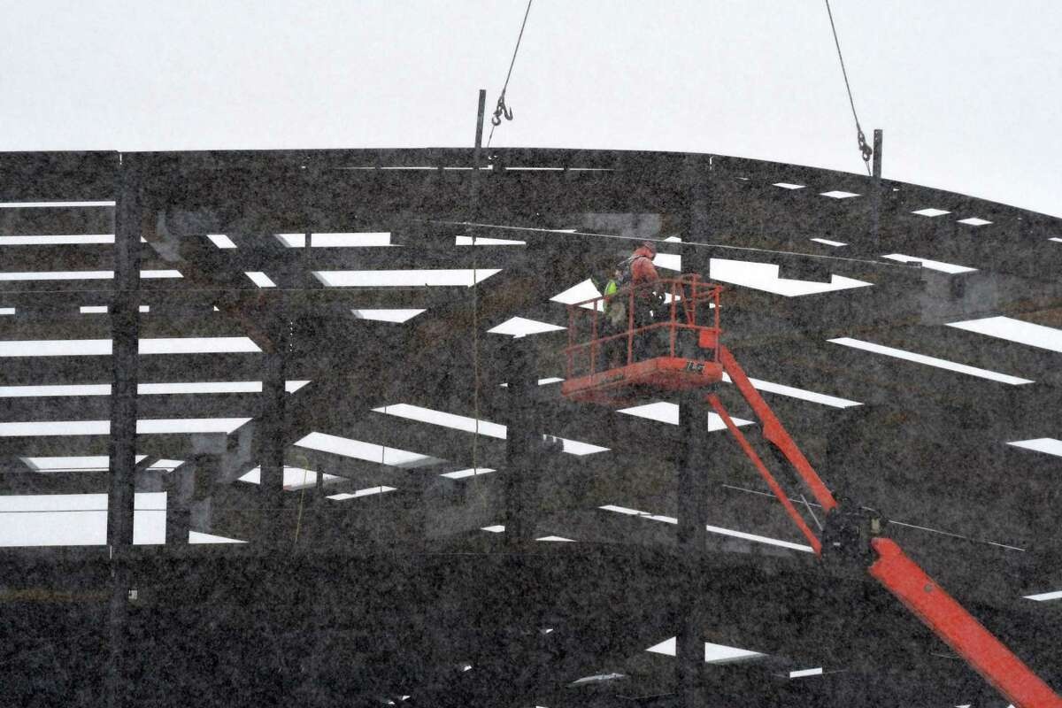 Workers battle the elements during construction of the Emerging Technology and Entrepreneurship Complex at the Harriman State Office Campus on Tuesday, Feb. 12, 2019, in Albany, N.Y. The ETEC facility is slated for completion in 2021. (Will Waldron/Times Union)