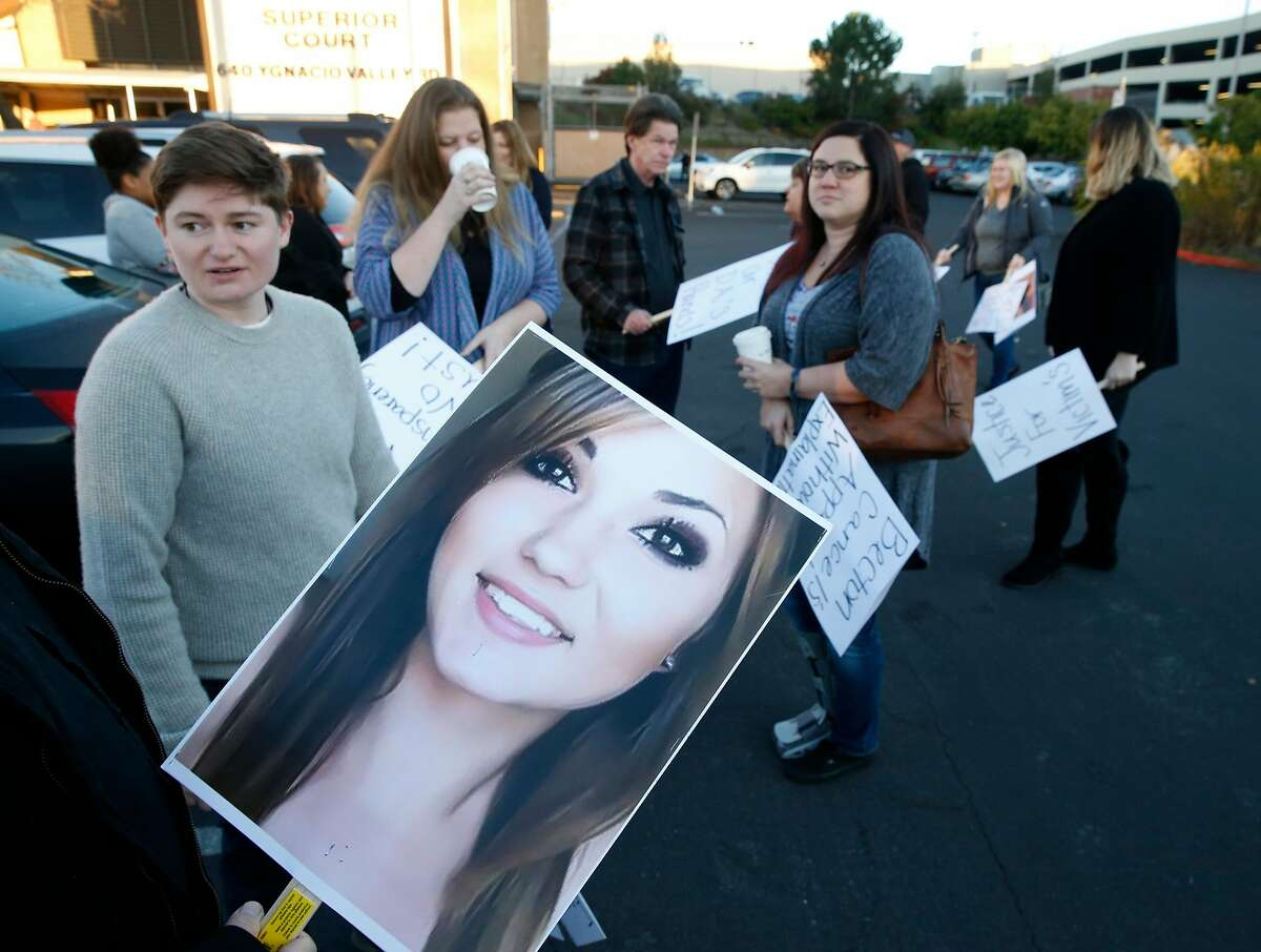Ashley Schwartz (left), Allie Sweitzer�s sister, joins family and supporters outside Contra Costa County Superior Court in Walnut Creek, Calif. on Thursday, Jan. 24, 2019 before a hearing for Allie Sweitzer's accused killer will be held in juvenile court. Authorities say Sweitzer, 20, was murdered in 2017 by a 15-year-old gang member and was originally ordered to stand trial in adult court but a new law that went into effect Jan. 1 says no one under the age of 16 can be tried as an adult.
