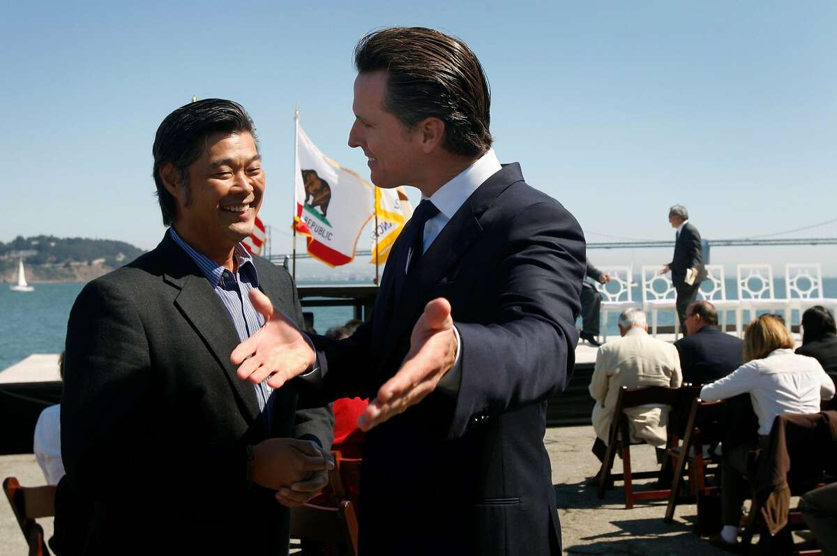 Lt. Gov. Gavin Newsom chats with Wax Museum owner and planning commissioner Rodney Fong before Gov. Jerry Brown signs AB 664 into law, which will help San Francisco finance the infrastructure, and create 8,000 jobs for the America's Cup yacht race, at an event held on Pier 37 in San Francisco, Calif. on Friday, Sept. 23, 2011.