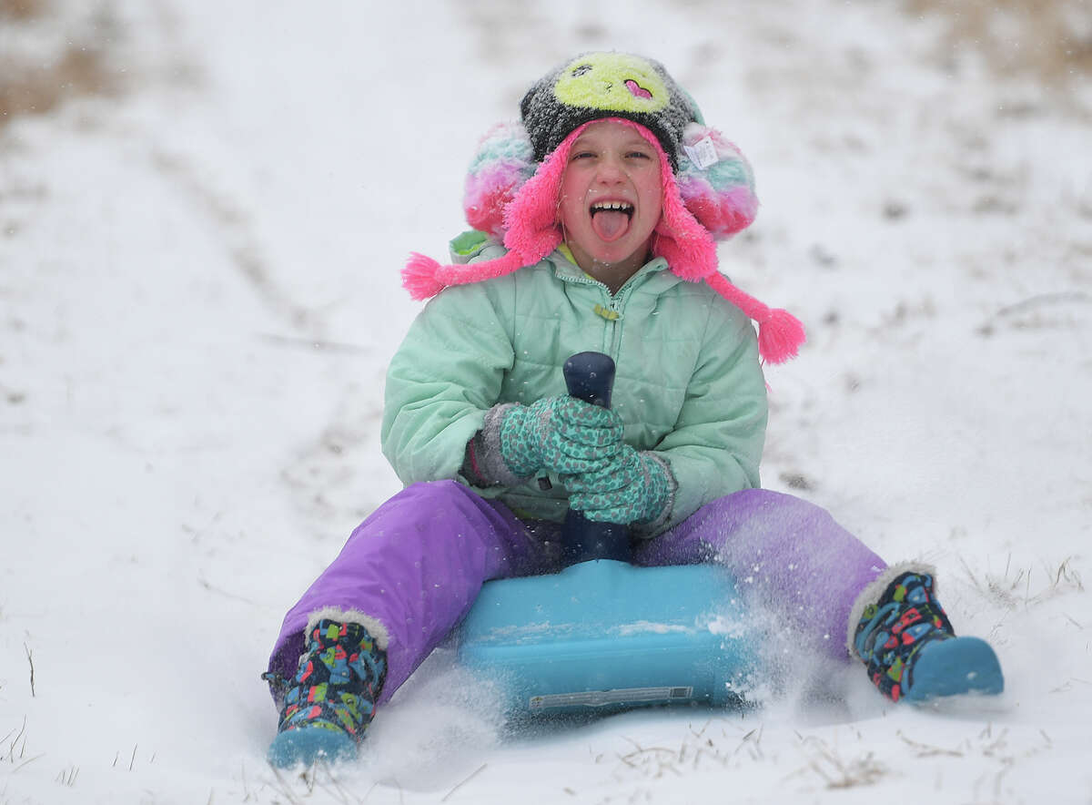 Anne Arnett, 6, of Fairfield, enjoys a snow day off from school with a morning of sledding at Sturges Park in Fairfield, Conn. on Tuesday, February 12, 2019.