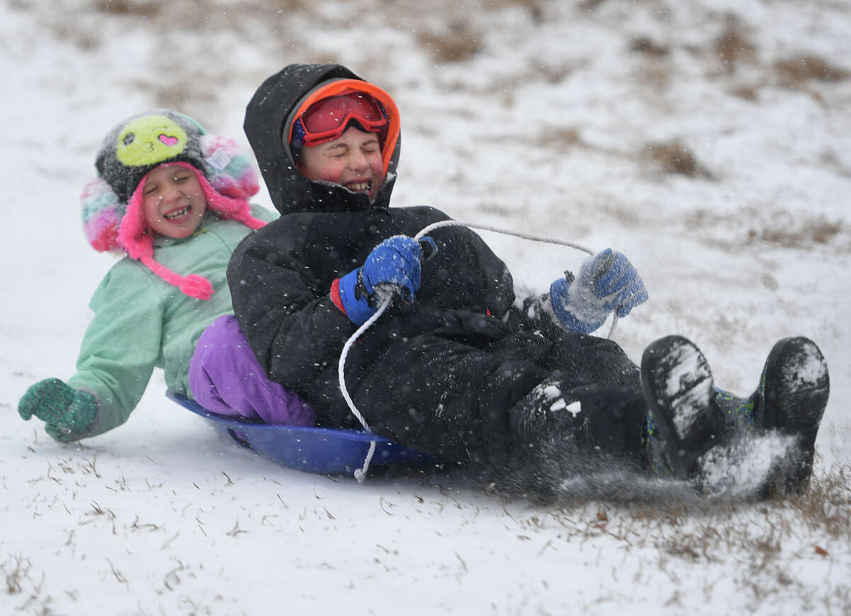 Siblings Anne, 6, and Ethan Arnett, 8, of Fairfield, enjoy a snow day off from school with a morning of sledding at Sturges Park in Fairfield, Conn. on Tuesday, February 12, 2019.