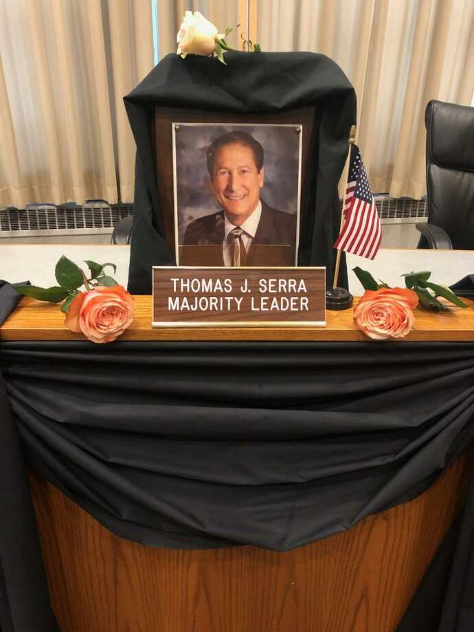 The seat of Middletown Common Council Majority Leader Thomas Serra, who died Saturday, is shrouded in black cloth and bunting. Council Clerk Linda Reed will be adding a state flag, in honor of Serra's longtime dedication to the Connecticut Technical High School System, as well as a purple rosette, the symbol of pancreatic cancer awareness. Photo: Linda Reed Photo