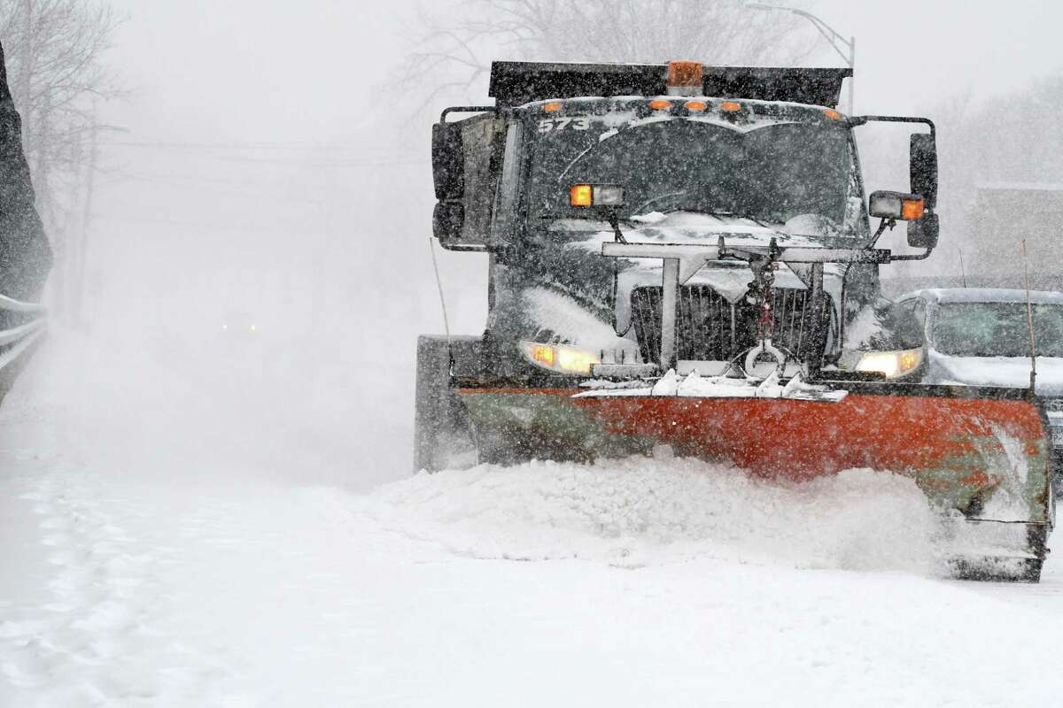 FILE - A city plow clears Northern Blvd. as a winter storm batters the Capital Region on Tuesday, Feb. 12, 2019, from Northern Blvd. in Albany, N.Y. (Will Waldron/Times Union)