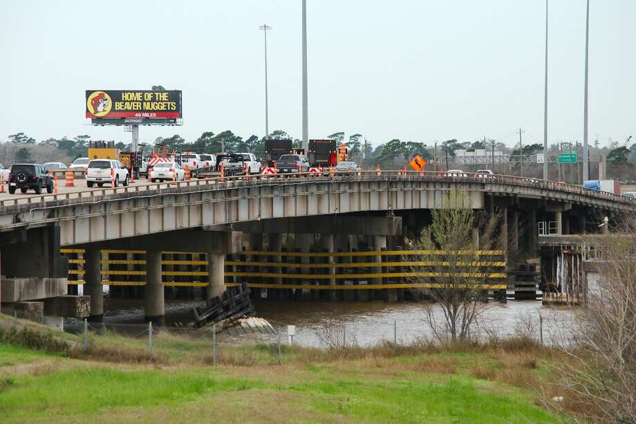 Traffic slows as crews assess and repair damage after a barge struck a supporting beam under I10 over the San Jacinto River Tuesday, Feb 12. Photo: Kirk Sides/Staff Photographer