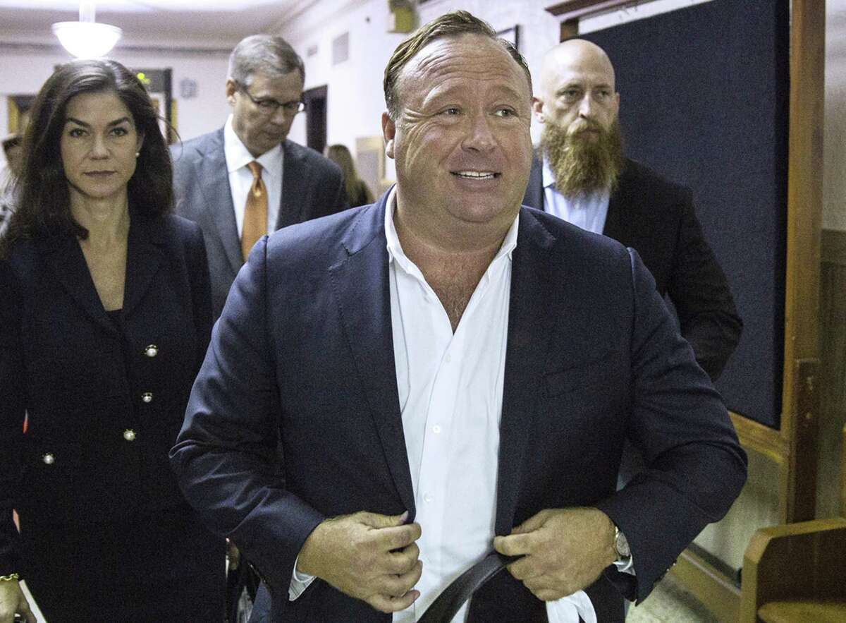 """In this April 17, 2017, file photo, """"Infowars"""" host Alex Jones arrives at the Travis County Courthouse in Austin, Texas."""