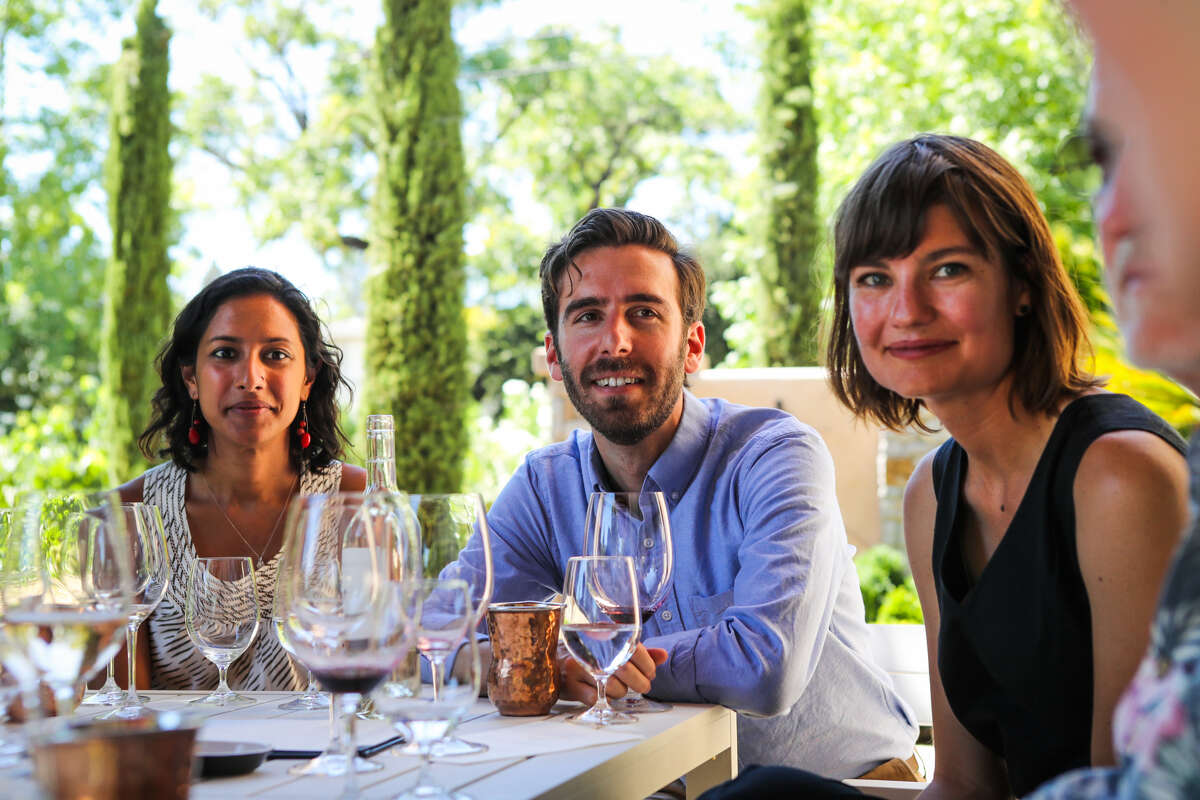 Nandita Gupta (from left), Teel Lidow, and Becky Jones listen to Jim Young during a tasting at Young Inglewood winery in Napa, California, on Saturday, July 30, 2016